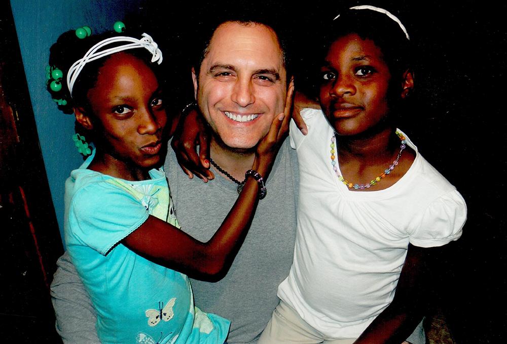 Chris Salamone with two Haiti girls