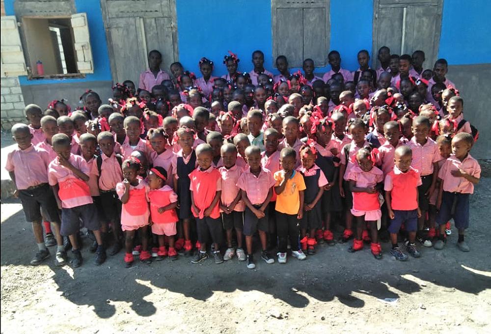 Chris Salamone in Haiti with childrens