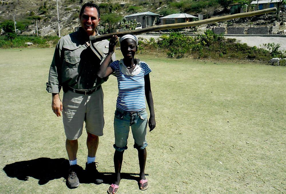 Chris Salamone in Haiti with woman